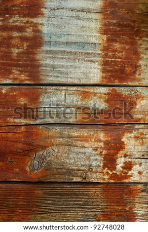 boards with rust from the barrel background vertical