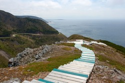 Boardwalk at the seaside and mountain highway along the ocean (Cabot Trail, Nova Scotia)
