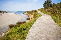 Boardwalk on the beach in Muxia, La Coruna, Spain