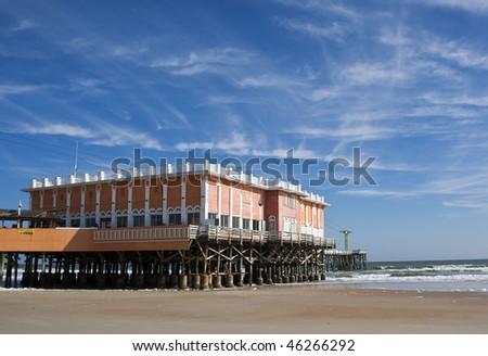 Boardwalk pier on the beach in Daytona Beach, FL.