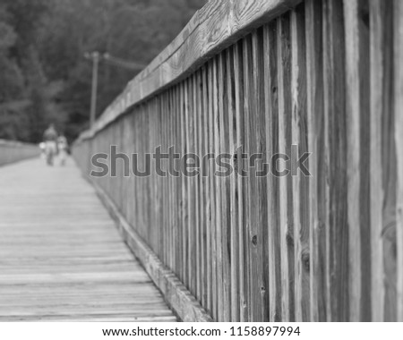 boardwalk rails and defocused child and parent