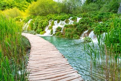 Boardwalk through the forest and little waterfalls of Plitvice Lakes National Park, Croatia