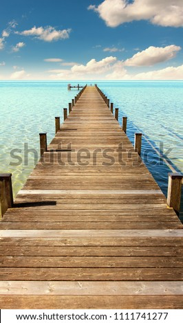 boardwalk to the horizon, turquoise water and blue sky with clouds, paradise landscape #1111741277