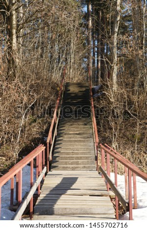 Boardwalker and stairs with railings ashore on a fall day in the park. #1455702716