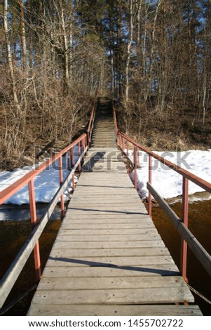 Boardwalker and stairs with railings ashore on a fall day in the park. #1455702722