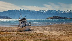 Boat aground on the beach of the General Carrera lake in quiet river, Chilean Patagonia