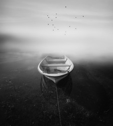 boat and fog black and white photography