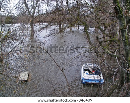 Boat and picnic table in a flooded park