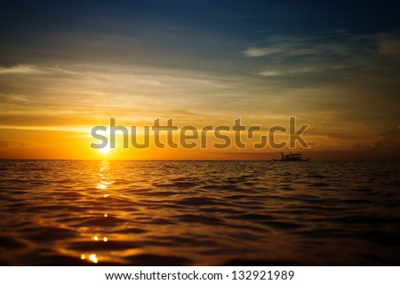 Boat And Sunset