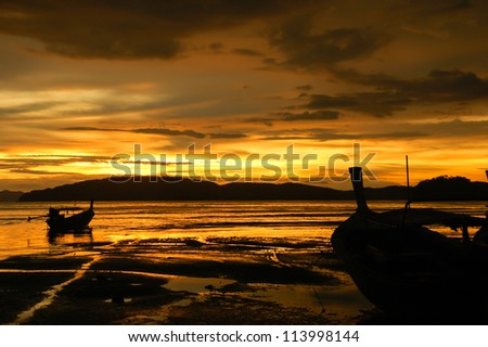 boat at beach and sunset - stock photo