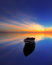 Boat at beach During sunrise / sunset