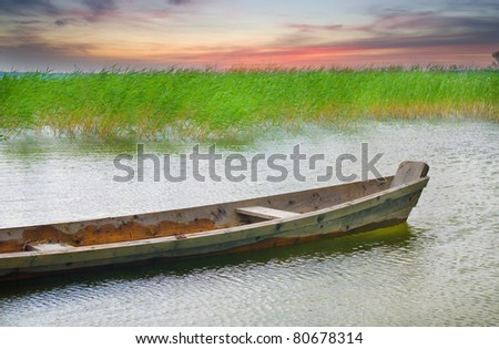 Boat at coast against a coming nearer thunder-storm - stock photo