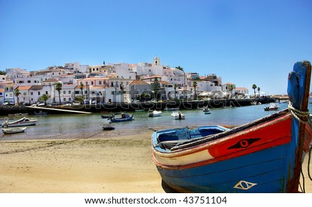 Boat at Ferragudo bay, Algarve. - stock photo