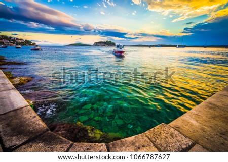 Boat at the coast of Hvar at dreamy sunset, Dalmatia, Croatia