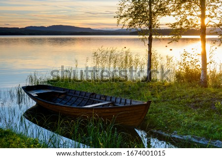 Photo of  Boat at the lakeside at sunset, Sweden