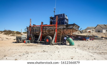 Boat being repaired, beached ship