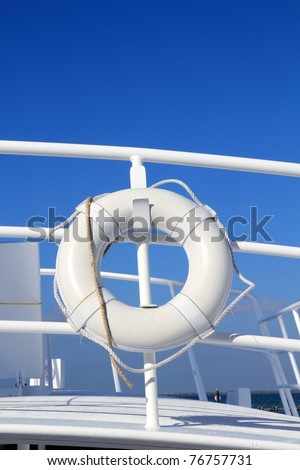 boat buoy white hanged in railing summer vacation blue sky