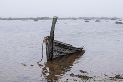 Boat crashed during a storm, White sea