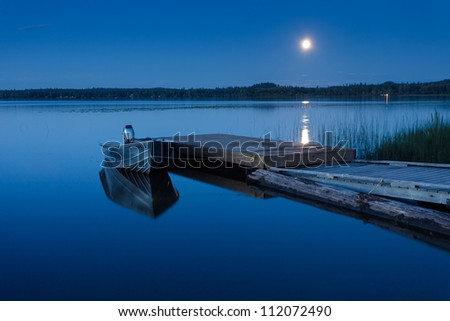 Boat Dock at a Moon-lit Lake