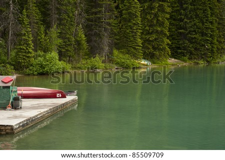 Boat dock with a canoe on a mountain lake