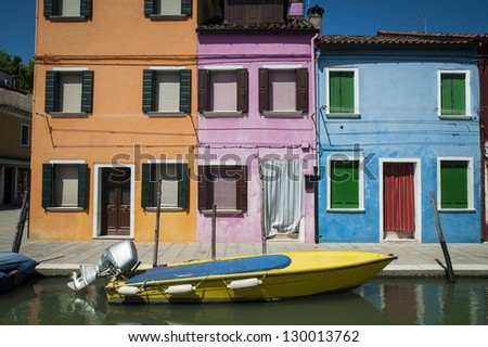 Boat docked on a canal, Burano, Italy