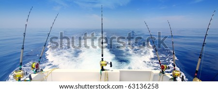 boat fishing trolling panoramic rod and reels blue sea wake [Photo Illustration]