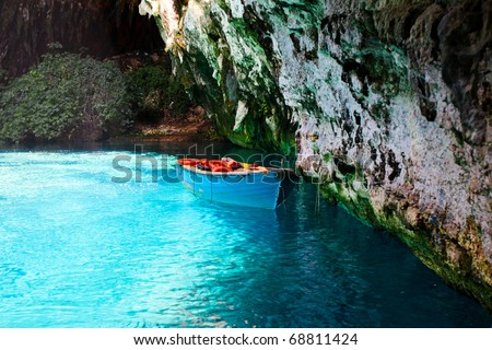 Boat Floating Near Rocks - stock photo