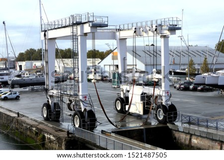 Boat hoist sitting at the dockside in the French port of La Rochelle