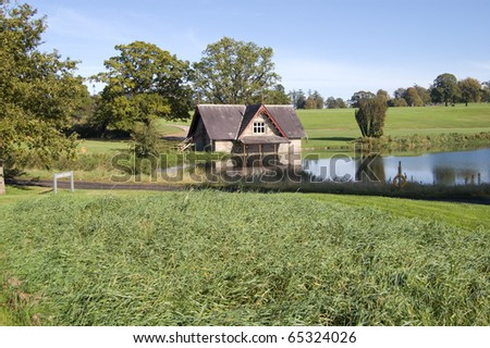 boat house on a river on a golf course