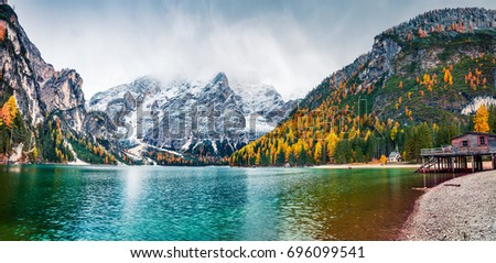 Boat hut on Braies Lake with Seekofel mount on background. Colorful autumn panorama of Italian Alps, Naturpark Fanes-Sennes-Prags, Dolomite, Italy, Europe. Traveling concept background. - Shutterstock ID 696099541