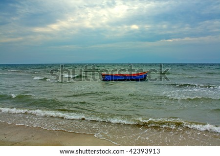 Boat in bad weather at sea