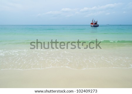 boat in blue sea and beach