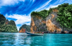 Boat in calm water of Phuket island bay relaxing travel landscape