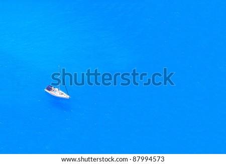boat in deep blue water view from above