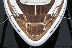Boat in harbor against dark water