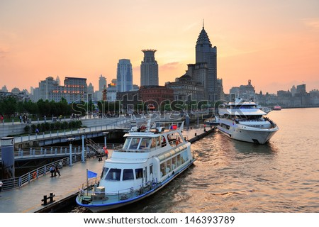 Boat in Huangpu River with Shanghai urban architecture at sunset in dock #146393789