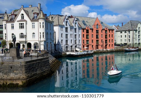 Boat in the harbour of Alesund Norway