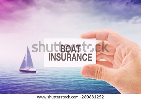 Boat Insurance Agent Holding Business Card, Sailing Boat on Open Sea in Background.