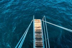Boat Ladder Upper the Sea . Ladder steps for nautical vessel