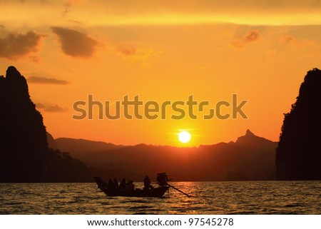 Boat looking sunset on lake