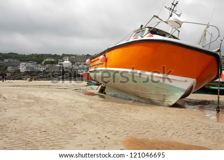 Boat moored at low tide, St Ives, Cornwall, England