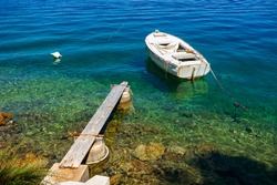 boat moored at the wooden pier in harbour of Losinj town, Croatia.