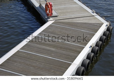 Boat mooring pontoon surrounded by calm water on a sunny day