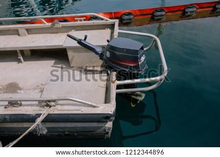 Boat motor black motors installed on the yacht #1212344896
