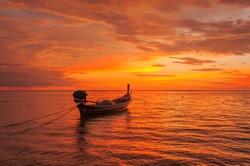 Boat near the beach at sunset itime. Nai Yang beach. Phuket. Thailand