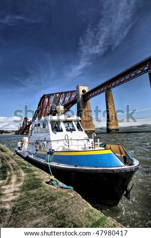 Boat next to Forth Bridge