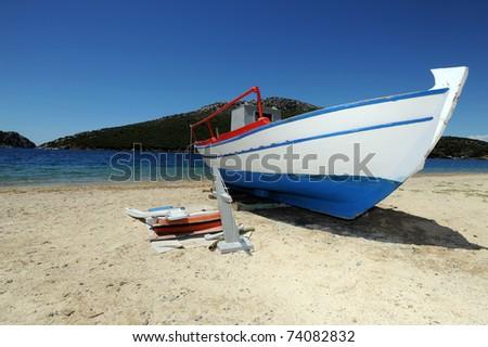 Boat on a beach in Porto Koufo, Sithonia, Greece