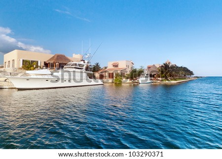 Boat on blue Caribbean water in Mexico
