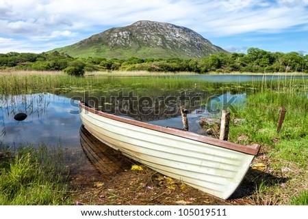 Boat on lake in Connemara National Park in Ireland.