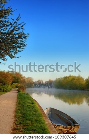Boat on River Thames in early morning - stock photo